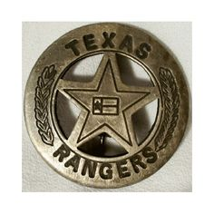 A solid copper double die struck with silver-plated antique finish Texas Rangers badge that is a cut out star in a circle. The badge measures 1 3/4 inches wide and has the clasp on the back to pin to a shirt.