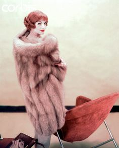 a fox fur coat by Fromm, 1958. Photo by Henry Clarke.