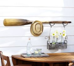 I could make this myself with an old oar and some hooks. Tali Oar Row Of Hooks #potterybarn