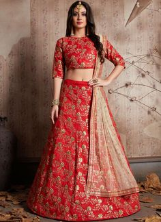 Endearing red raw silk lehenga choli online for women which is crafted from raw silk fabric with exclusive embroidery. Shop this stunning partywear lehenga choli which comes with raw silk blouse and net dupatta. Bridal Lehenga Online, Designer Bridal Lehenga, Indian Bridal Lehenga, Lehenga Choli Online, Raw Silk Lehenga, Banarasi Lehenga, Red Lehenga, Floral Lehenga, Lehenga Blouse