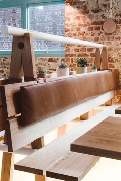 Timber and Leather Booth Seating at La Fonda by Techne Architects Melbourne.