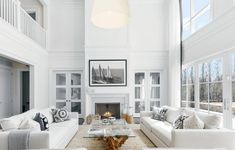 All white transitional living room decor with white maddox sofas and reclaimed wood coffee Navy Living Rooms, Coastal Living Rooms, Living Room White, Living Room With Fireplace, Living Room Modern, Living Room Sofa, Small Living, Fireplace Wall, Fireplace Design