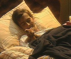 David Tennant / Ten tucked into bed with a wee little teddy bear and smiling about it. *dies*