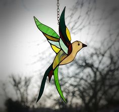 Stained glass bird - tiffany glass bird. A stained glass suncatcher.