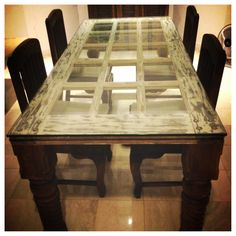 Dining table made of an old door. SO COOL!