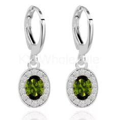18KTGF WHITE GOLD PERIDOT EARRINGS 18KTGF Stamped Earrings . Free Peridot Gemstone . White Sapphire Surrounds the green peridot gemstone . Brand new . NEVER WORN .  Wrapped and shipped with care Ice Jewelry Earrings