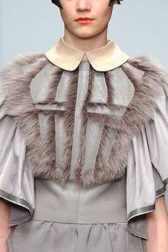 Fur panels, Peter Pan collars and draped sleeves kept a feminine feel to the @BoraAksuStudio show #LFW