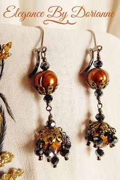 Rich Gothic Victorian Dangle Earrings With Rust Pearls, Gunmetal Crystal Tassels, and Rust Crystal Accents. The rust pearls are cradled within antique gold bead caps, cascading down to a tassel of antique gold, showering with gunmetal crystals. Etsy Jewelry, Handmade Jewelry, Jewellery, Artisan Jewelry, Halloween Jewelry, Victorian Gothic, Gothic Jewelry, Bead Caps, Vintage Gifts