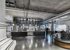 """American studio AvroKo has completed a cafeteria and coffee bar in the new San Francisco headquarters for tech company Dropbox, providing a """"place of comfort"""" that aims to keep employees from leaving the office. The Tuck Shop and Dropbox Cafe are located inside the recently completed offices for Dropbox, a major provider of online file hosting.  Intended to be used for dining and casual meeting.."""