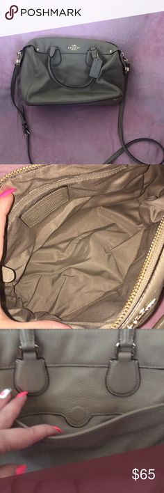 Coach cross body bag Worn but I'm good condition I put a picture up of a little black smudge by the button and the feet on the bottom Coach Bags Crossbody Bags