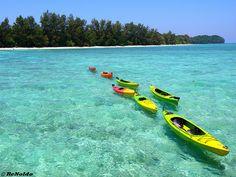 Row, Row, Row your boat, gently down the sea. Mantanani Island, Sabah, Malaysia.