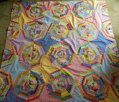 another spider web quilt.  Makes it look even more scrappy when you use different fabric for the kite section.