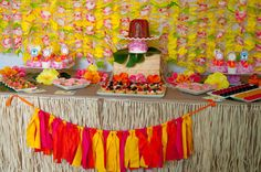 Dessert table at a Luau Party (love the lei backdrop!) #luau #party
