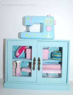 We found a fun wooden piece with glass doors at Hobby Lobby {40% off}.   We thought it would make a great sewing cabinet.   First w...