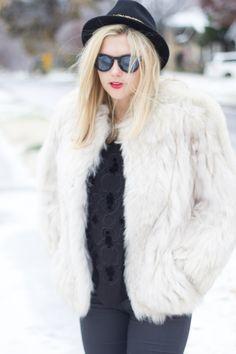 fur jacket and black hat