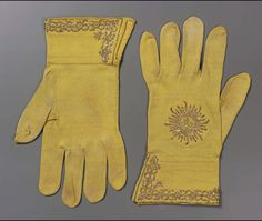 """Knitted yellow silk embroidered with gilt-silver wire and brass sequins; gauntlet of double thickness. Monogram """"I H S"""" on back, spiraling decorative border on guantlet. Baroque Fashion, Vintage Fashion, Vintage Accessories, Fashion Accessories, Renaissance, Vintage Gloves, Crochet Gloves, Dress Gloves, Fashion Essentials"""
