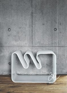 Wave table by BEdesign. The smooth shape of this piece of furniture is inspired by the beautiful seaside in the Finnish archipelago. It can be used in various ways, thanks to its versatile shape, e.g. as a magazine rack or a table. No matter how you decide to use it, it becomes an eye-catcher.  © BEdesign