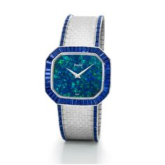 Jewellery wristwatch in white gold set with 154 baguette-cut sapphires, opal dial. Piaget ultra-thin hand-wound movement 9P. Date: 1981