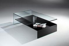 Unique and Awesome Modern Coffee Table Design with Glass Rectangular Table Top and Black Newspaper Storage Idea