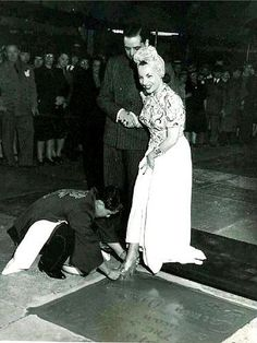 Carmen Miranda placing her 6inch wedgie prints in cement.