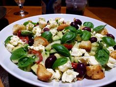 Avocado, cucumber, olive feta and fresh basil salad topped with croutons