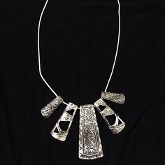 Stunning new intricate detail tribal necklace! Stunning in bright silver tone with beautiful etching and shapes! Jewelry Necklaces