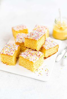 This old fashioned school cake topped with a simple glaze and sprinkles is just the simple retro bake we all need right now! Easy to make all in one bowl and delicious served plain or with warm vanilla custard. Sponge Cake Recipes, Homemade Cake Recipes, Easy Baking Recipes, Cake Mix Recipes, Cupcake Recipes, Cupcake Cakes, Dessert Recipes, Biscoff Recipes, Cupcakes