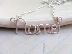 Silver  8 Letters Wire Word Necklace Word Jewelry Wire Wrapped Grad Gifts Under 20. $16.95, via Etsy.