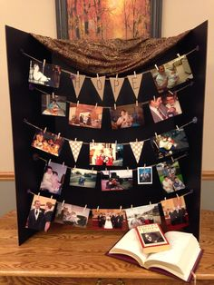 Funeral or Memorial photo board using twine, mini clothespins and a trifold board. Doesn't damage photos! We also laid out items that represented her favorite things (Bananagrams, cribbage, crosswords, books, etc.)