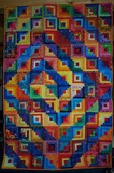 Log Cabin Spiral quilt - kinda makes me dizzy, but it's a good way to use up scraps.  :)