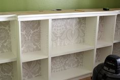 DIY: How to add crown molding to bookshelves to make them look like built-ins...great idea for my craft storage hubby is making!