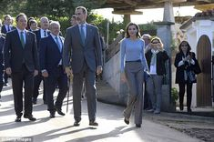 The Spanish Queen also accesorised with a blue clutch bag, a dark blue belt as well as blue stilettos