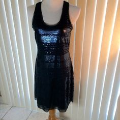 Black Sequins Dress Black sequins sleeveless, pullover dress. Fully lined.  Sheer material with sequins sewn all over it!  Never worn. Measurements laying flat:  Bust 17 inches, Hip 19 inches, Length 34 inches (PB1) Max Studio Dresses Prom