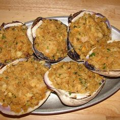 A traditional RI Style stuffed hard shell clam...served with a lemon wedge and tobasco sauce.