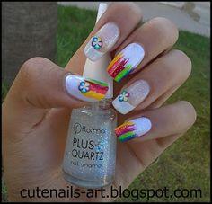 http://cutenails-art.blogspot.com/2012/10/rainbow-flowers-nail-art-using-fimo.html rainbow nail art