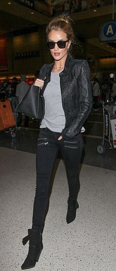 Rosie Huntington-Whiteley showcases her style in skinny jeans and leather jacket