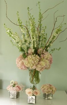 Blush Pink And Green Wedding Centerpieces..... would change pink hydrangeas to more of a cream/ or choose different flowers completely by amber