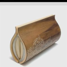 Walnut and leather clutch.