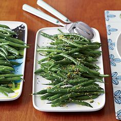 Instead of just steaming or boiling green beans, Katie Workman first sautés them in butter and garlic, then simmers them in chicken broth...