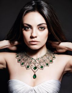 Mila Kunis in Gemfields emerald statment necklace