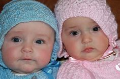 Sweetest Boy Girl Twins in hand knitted outfits: These twin babies are 4 months old in this photo and we were given these outfits by a close family friend. It was much too hot for them to wear them but