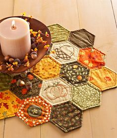 Feature rich colors and autumn motifs in quilts, wall hangings, and table toppers that are perfect for the fall season. Quilted Table Toppers, Quilted Table Runners, Fall Table Runner, English Paper Piecing, Quilting Projects, Fall Sewing Projects, Halloween Quilts, Fall Quilts, Paper Embroidery