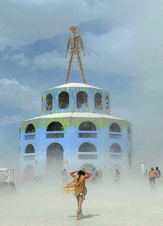 Burning Man: A woman walks toward the Man on a dusty afternoon at Burning Man festival
