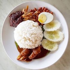 Nasi Lemak is a Malaysian dish where the fragrant rice was cooked in coconut milk. It was served hot on a piece of banana leaf, eaten with sambal (hot chili sauce), hard-boiled egg, ikan bilis (anchovies), peanuts and slices of cucumber.  For some extra luxuries, some may add a side dish of sambal sotong/udang (hot chili squid/shrimps), chicken rendang (spicy curry-like chicken) or any other local dishes.  This dish is served all day nationwide in Malaysia, from breakfast to dinner.