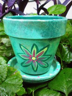 love these hand-painted flower pots as an idea for wedding favors!