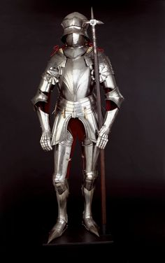 """A rare example of Gothic Armor (15th century) in the collection """"Armor for Combat"""" at The Higgins Armory Museum. Depicted with a war-hammer."""