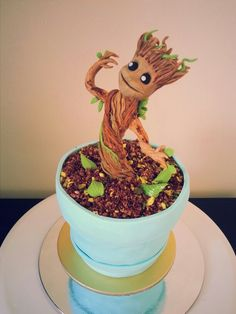 Baby Groot cake. Pot made of layered pistachio cake and the soil is a mix of cake crumbs and ground pistachio.