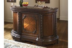 """The North Shore Bar from Ashley Furniture HomeStore (AFHS.com). A deep rich stained finish and exquisite details come together to create the ultimate in grand traditional design with the elegance of the """"North Shore"""" dining room collection."""