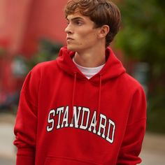 """Going casual, Luc Defont-Saviard sports a """"Standard"""" red hoodie from Sandro. Hoodie Outfit, Red Hoodie, Sweater Hoodie, Men's Collection, Winter Collection, Mens Sweatshirts, Hoodies, French Brands, American Standard"""