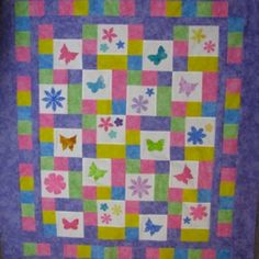 I found this amazing quilt at the Accuquilt Quilters Spotlight.  Dancing Garden   Used Studio Butterfly, Studio Flower #11, Studio Flowers Trio Long Cut